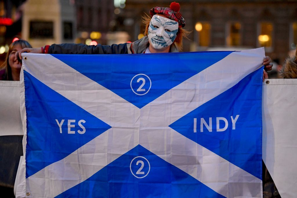 Independence supporters gather in George Square, Glasgow, following Monday's announcement about IndyRef2