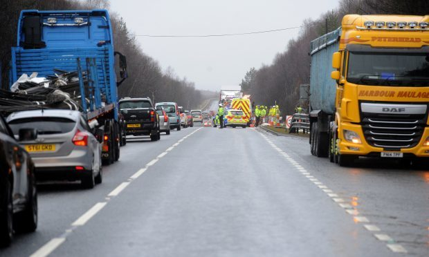 The road had to be hosed down after fish spilled over the A9.