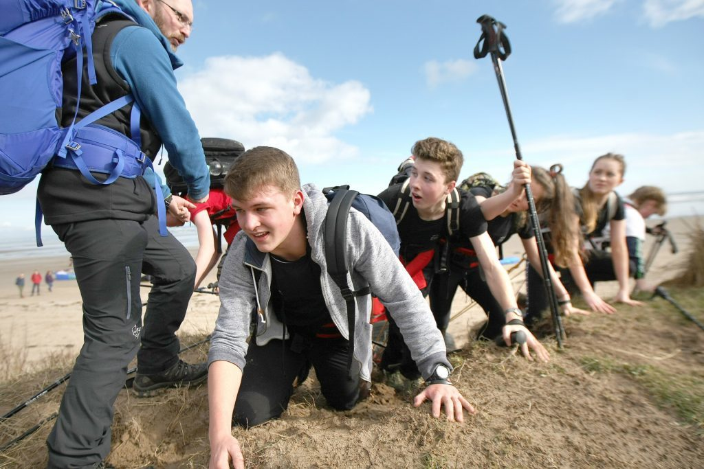 "Craig Mathieson instructs the teenagers to do ""polar press ups"" on the beach!"