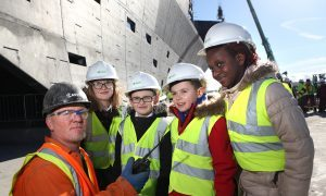 Sarah McGillivary, Dominic Nelson (both Rosebank Primary) and Jak Adams and Fiona Okeke (both Our Lady's) starting the topping off ceremony over the radio with foreman Sean McGee.