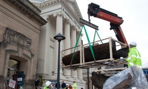 The 3,000 year old log boat being lowered into Perth Museum and Art Gallery.