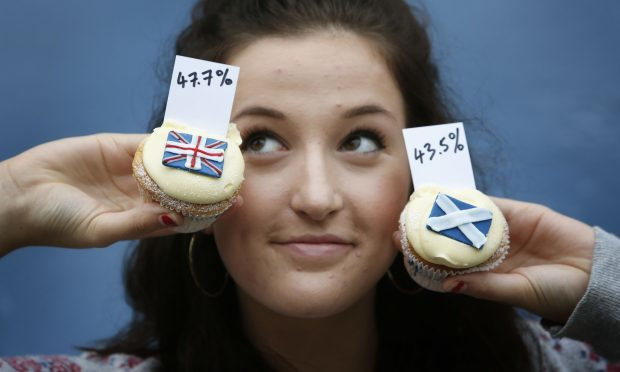 Pippa Perriam holds cupcakes at Edinburgh bakery Cuckoo's that show the results of their cupcake referendum opinion poll survey where the public could buy a Yes, No or Undecided cupcake during the last independence referendum.
