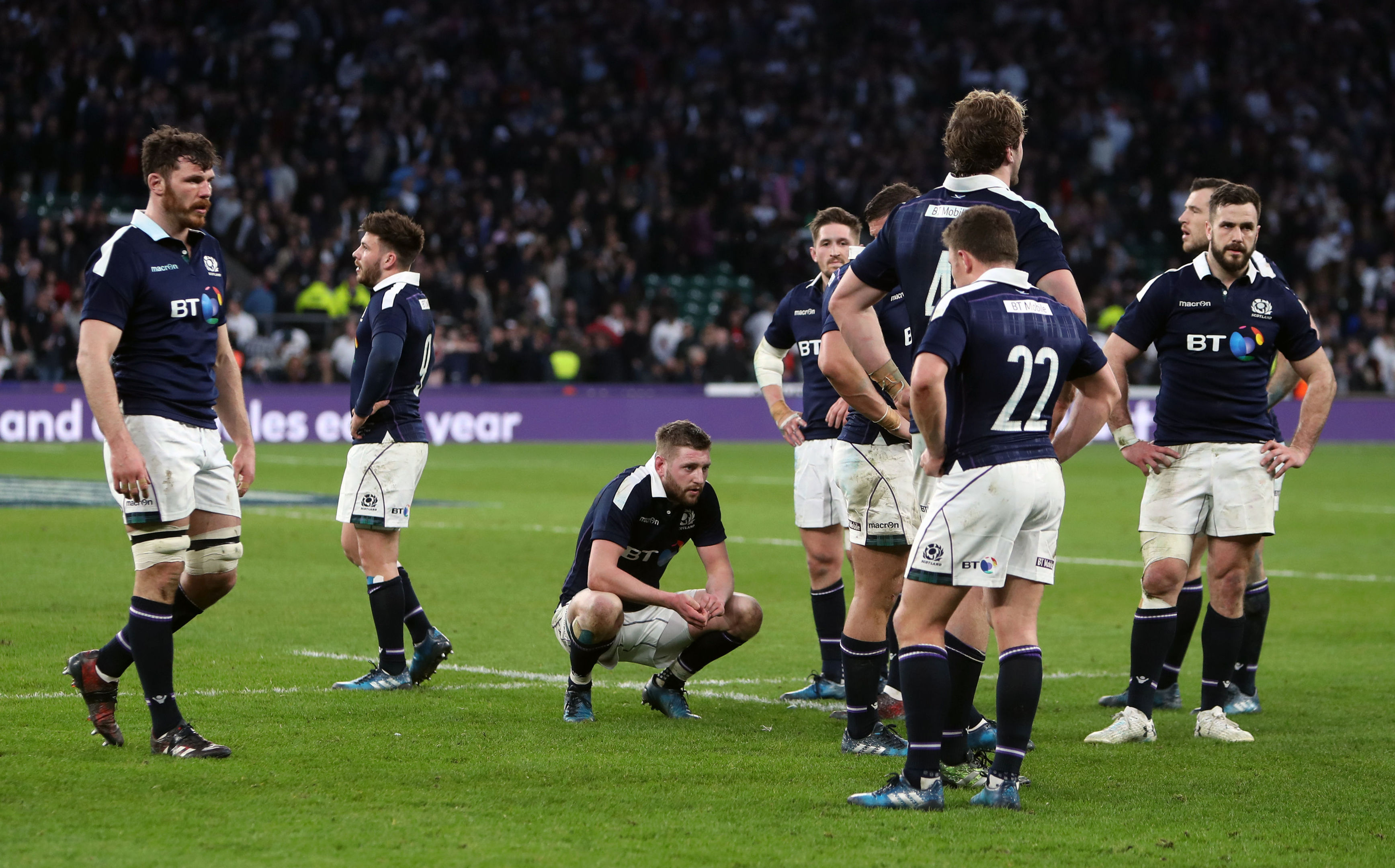 Dejected Scottish players at the end of Saturday's 61-21 defeat at Twickenham.