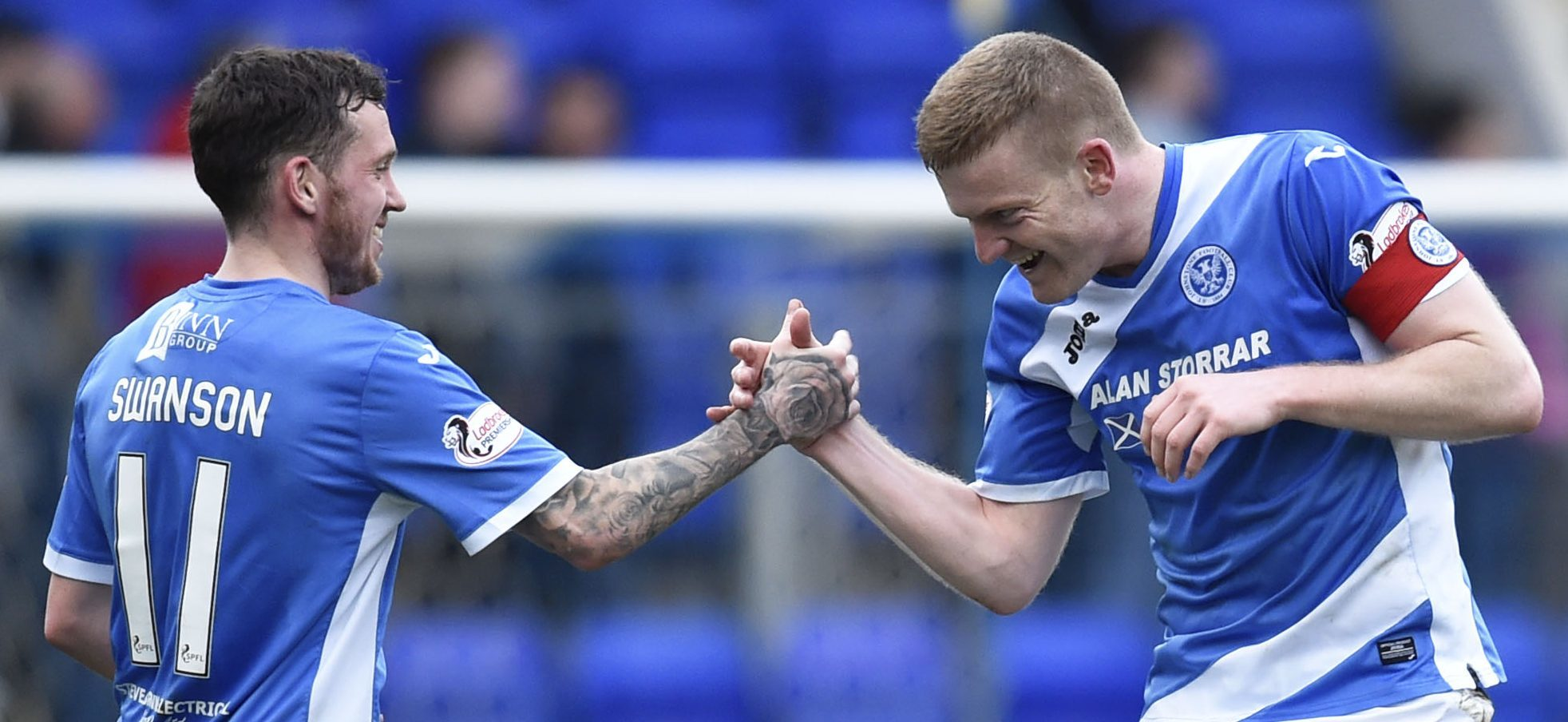 Delight for Saints Danny Swanson, left, and Brian Easton at the final whistle.