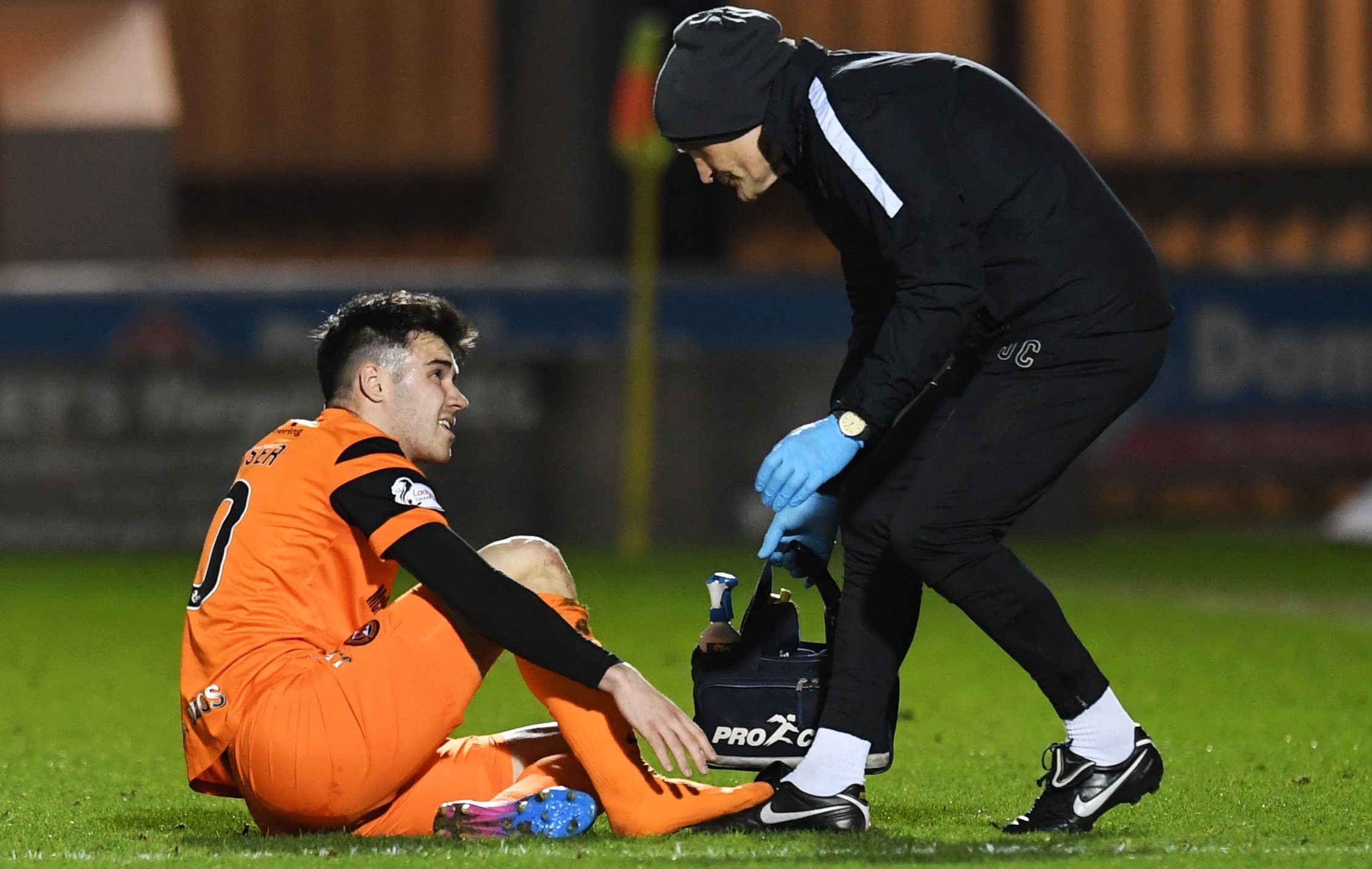 Scott Fraser receiving treatment from the club physio.