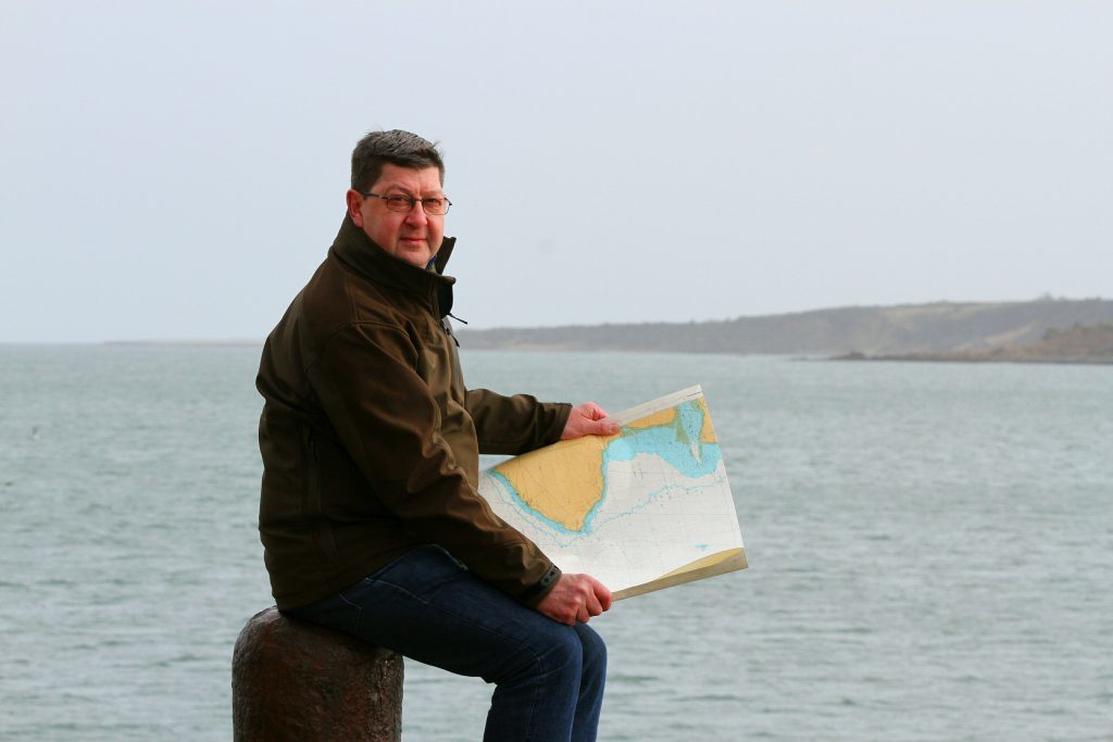 Maritime archaeologist Neil Dobson from St Andrews looking out into St Andrews Bay from the pier