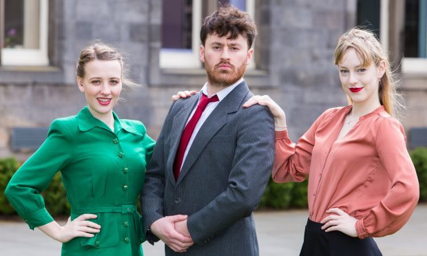 Super Rich Connor Powell  with his assistants Mille Postle, left, and Elizabeth Beattie, right, get ready to perform Urinetown at the On The Rocks Festival in St Andrews.