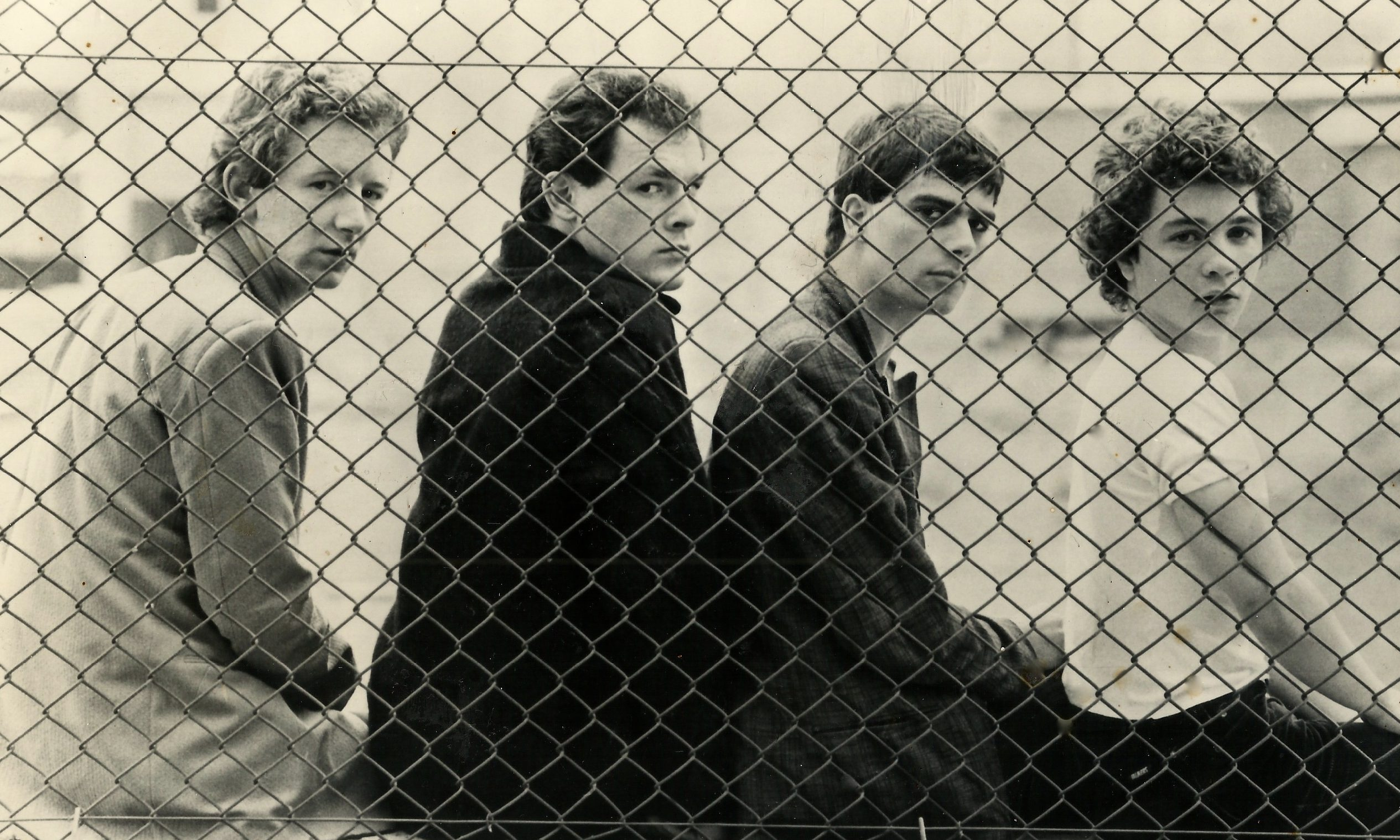 The Associates's first ever promo shot, taken in 1978. Stephen Knight sits on the far left, beside Billy Mackenzie.