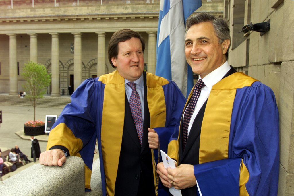 John Suchet received an honorary degree from Dundee University alongside George Robertson in 2000