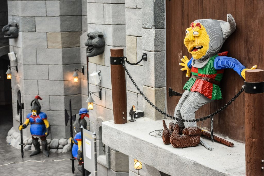 Photo of a lego model in front of the Kingdoms entrance gate.
