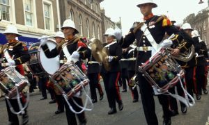 The marines parade through the High Street.