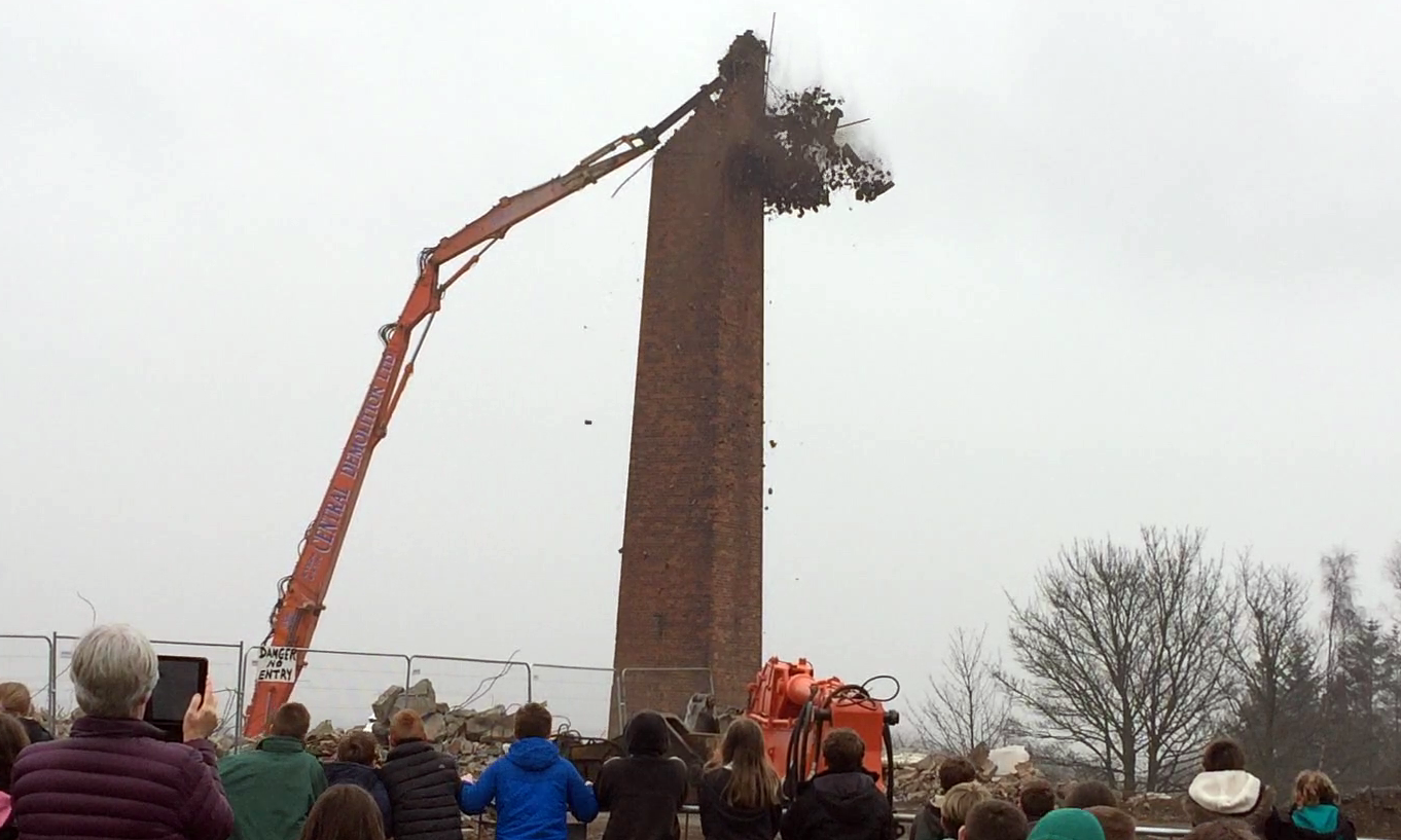The chimney is brought down chunk by chunk.