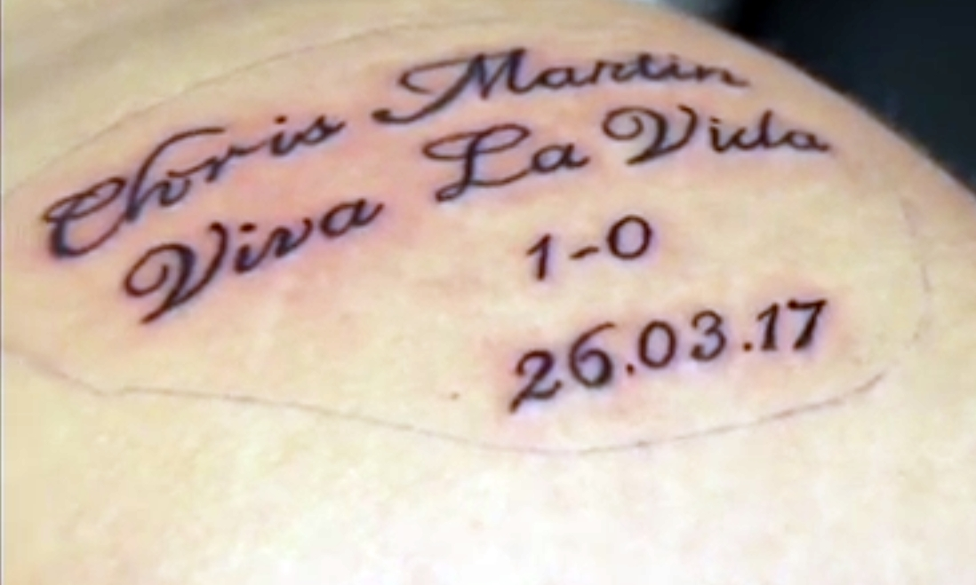 Video fife football fan grins and bares it with chris for Chris martin tattoos