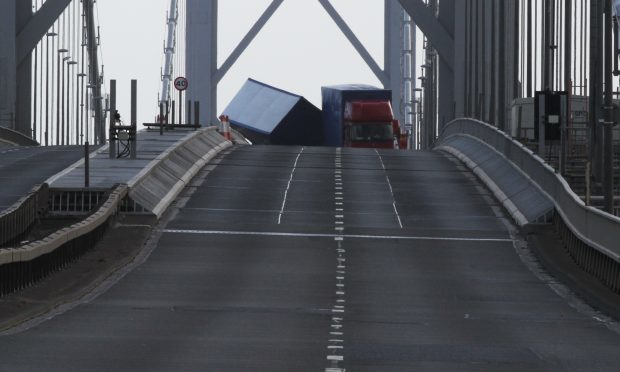 A lorry overturned on the Forth Road Bridge on Tuesday resulting in both carridges being closed and traffic chaos around Queensferry.