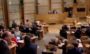 Roseanna Cunningham angrily jabbing her finger at Conservative MSPs