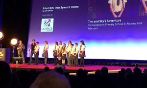 The pupils take to the stage at the Get Into Films awards in London.