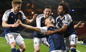 Scotland's Chris Martin celebrates his late goal with his team mates.