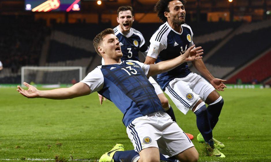 26/03/17 FIFA WORLD CUP QUALIFYING   SCOTLAND v SLOVENIA   HAMPDEN PARK - GLASGOW   Scotland's Chris Martin celebrates his late goal with his team-mates
