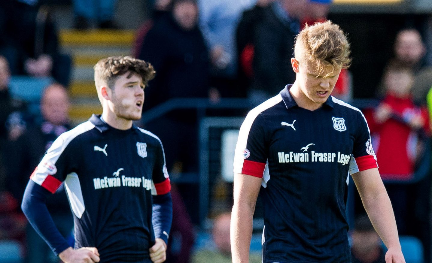 Dejected Dundee players at full-time.