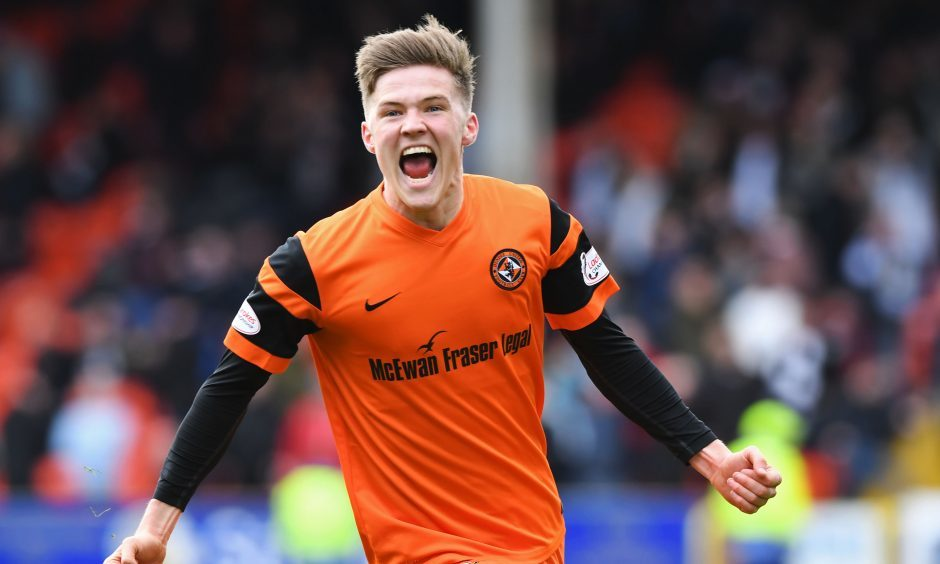 Dundee United's Blair Spittal celebrates after scoring the winner.