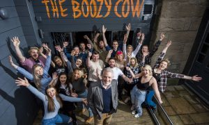 The Boozy Cow staff are ready to welcome their first customers.