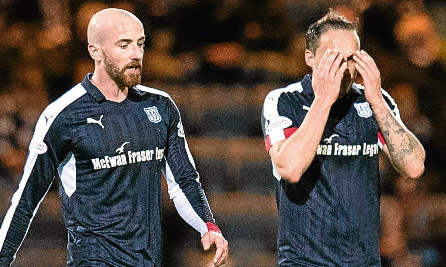 Dundee players James Vincent and Tom Hateley show their feelings after going 0-7 down to Aberdeen.