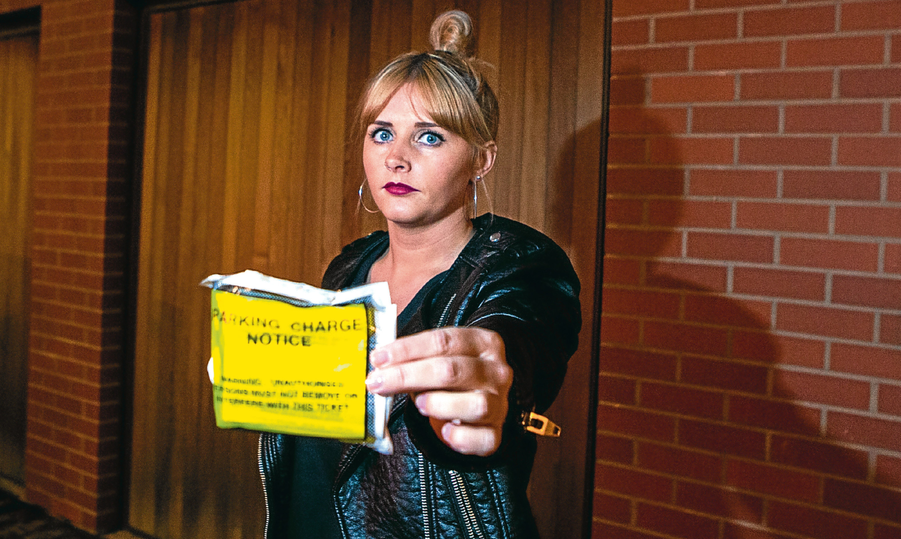 Carly Mackie has been slapped with a £24,500 parking fine.
