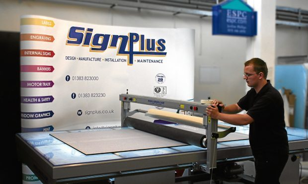 A worker at the Dalgey Bay headquarters of Sign Plus