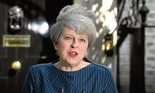 Prime Minister Theresa May makes a statement in Downing Street announcing a snap general election on June 8.