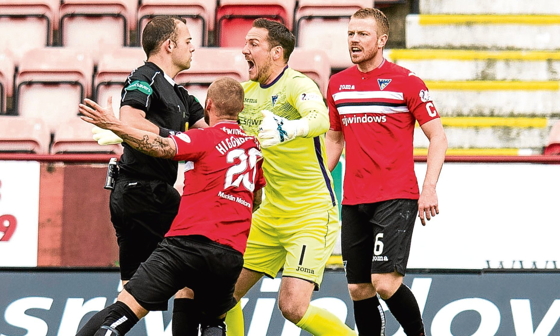 Dunfermline players contest the penalty decision.