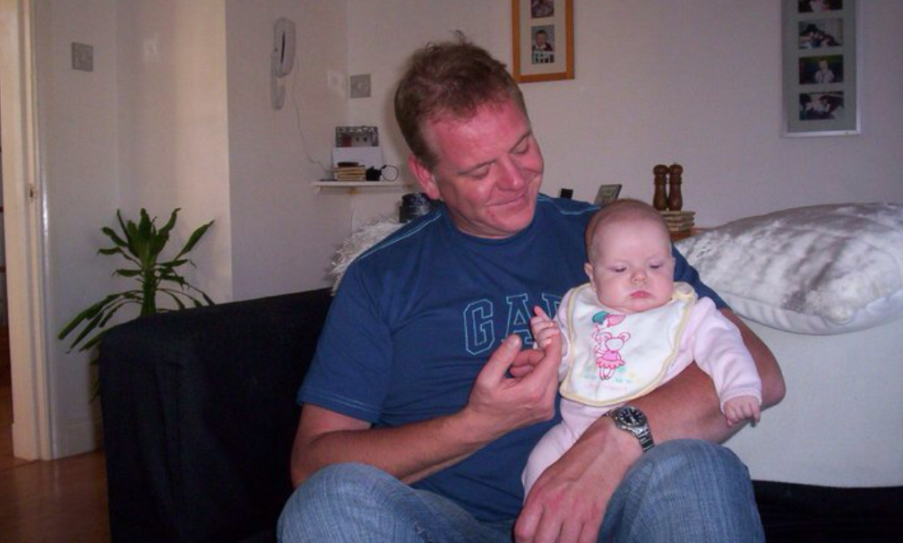 Stuart Beharrie with his granddaughter, Ellie, who he hopes to take to Disneyland Paris.