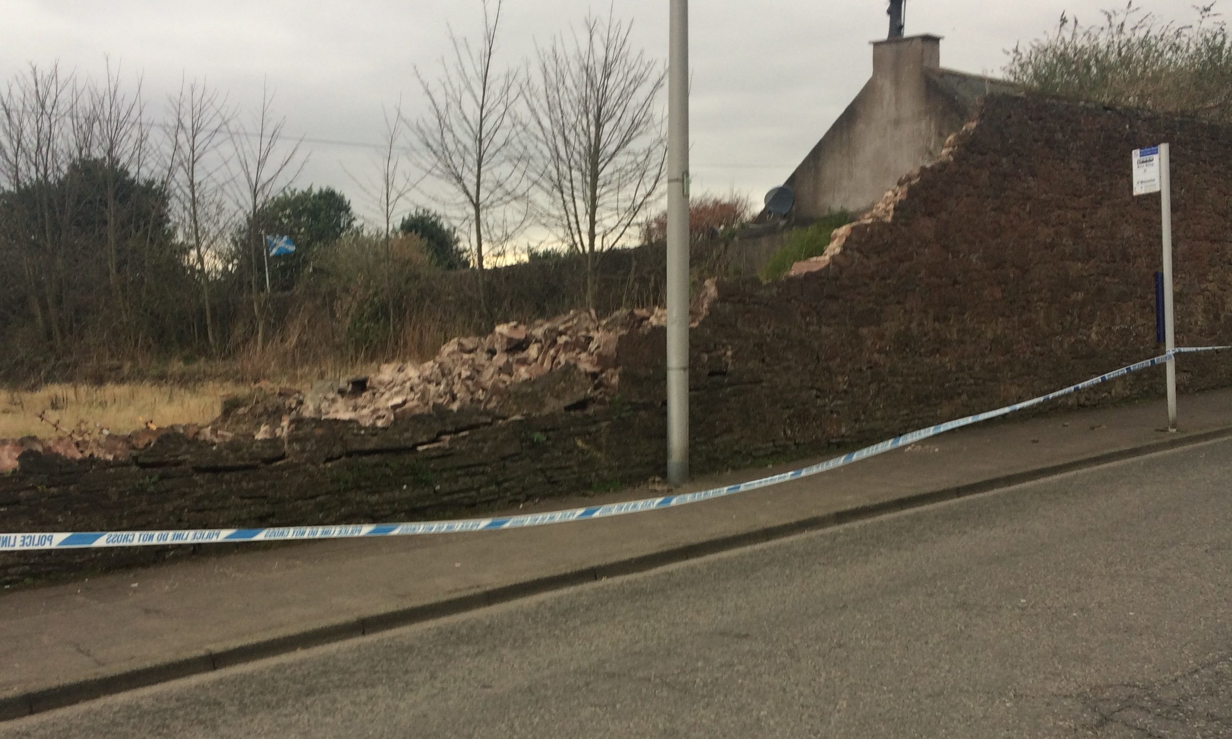 The collapsed wall on Hayshead Road.