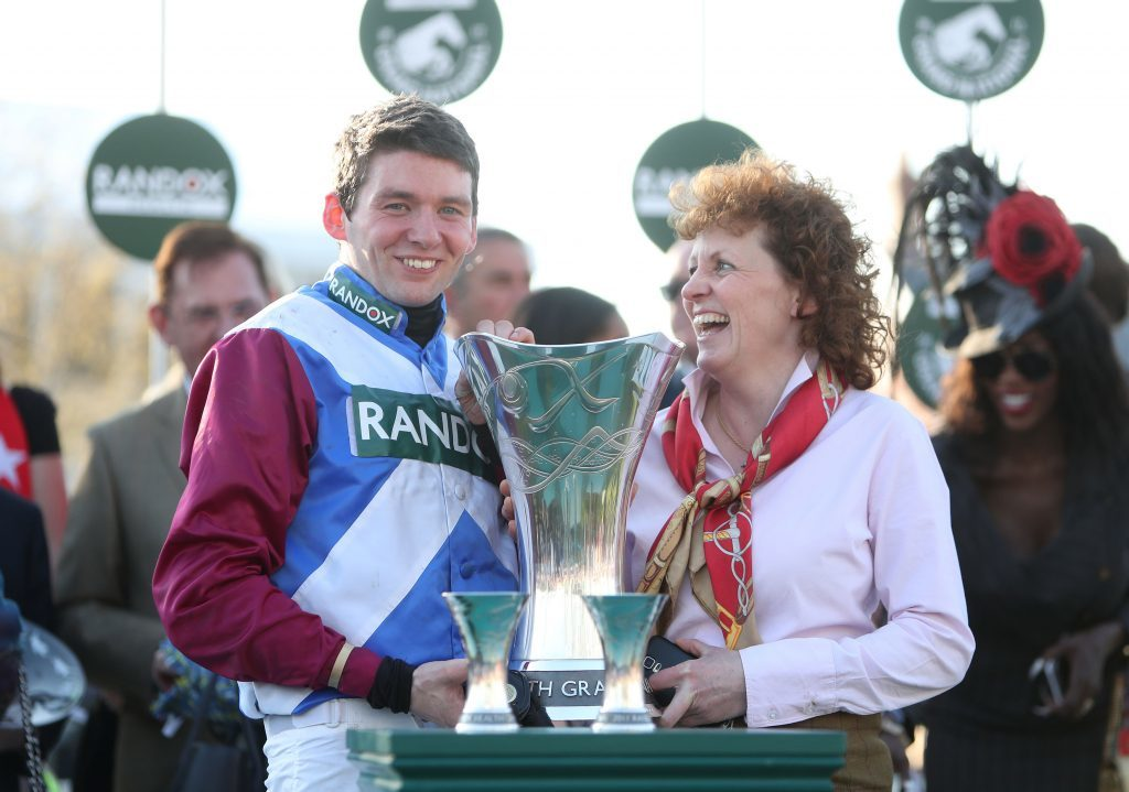 Jockey Derek Fox and trainer Lucinda Russell celebrate with the trophy after winning the Randox Health Grand National on One For Arthur.