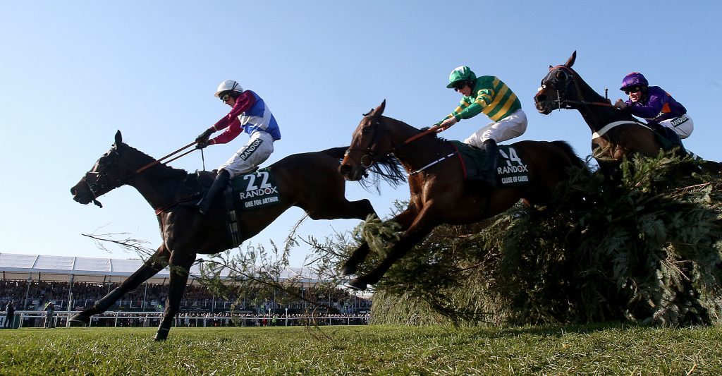 One For Arthur ridden by jockey Derek Fox jumps the last on the way to winning the Randox Health Grand National.
