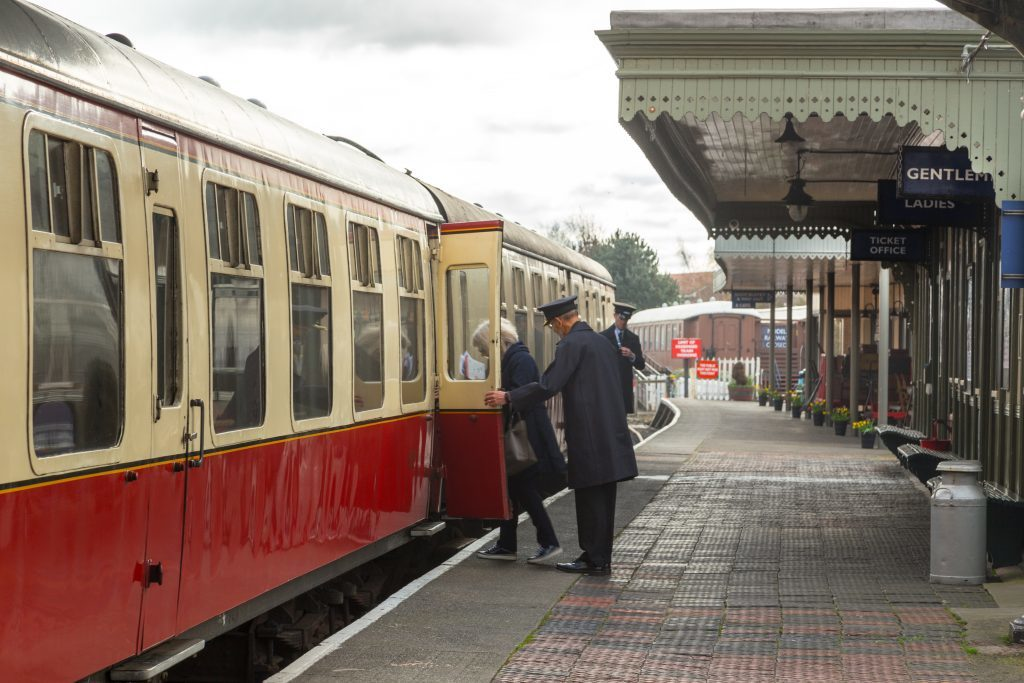 Passengers being helped onboard a steam train at Bo'ness and Kinneil Railway Station.