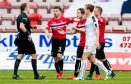 Dunfermline players contest a decision in their match with Falkirk. The game has now proved controversial off the field as well.