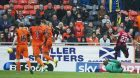 Lewis Vaughan scoring against United.
