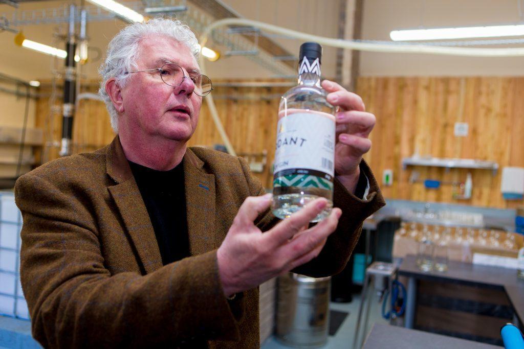 Andrew Mackenzie inspecting the latest bottles of Verdant.