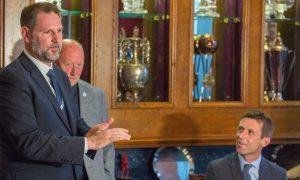 John Nelms, left, introduces Neil McCann to the media.