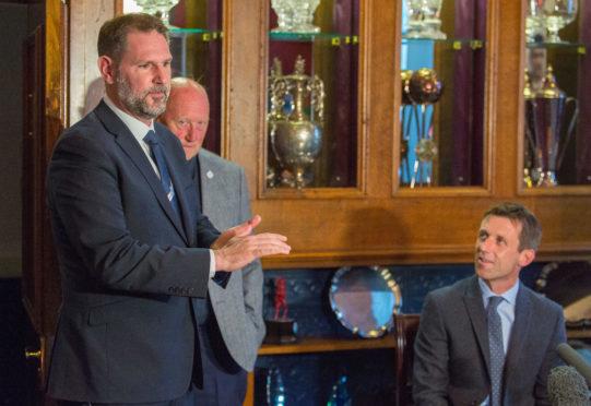 John Nelms welcomes Neil McCann to Dens as manager.
