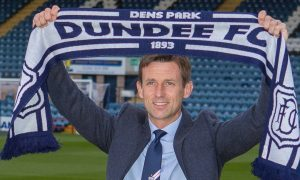 Neil McCann settles back in at Dens Park.