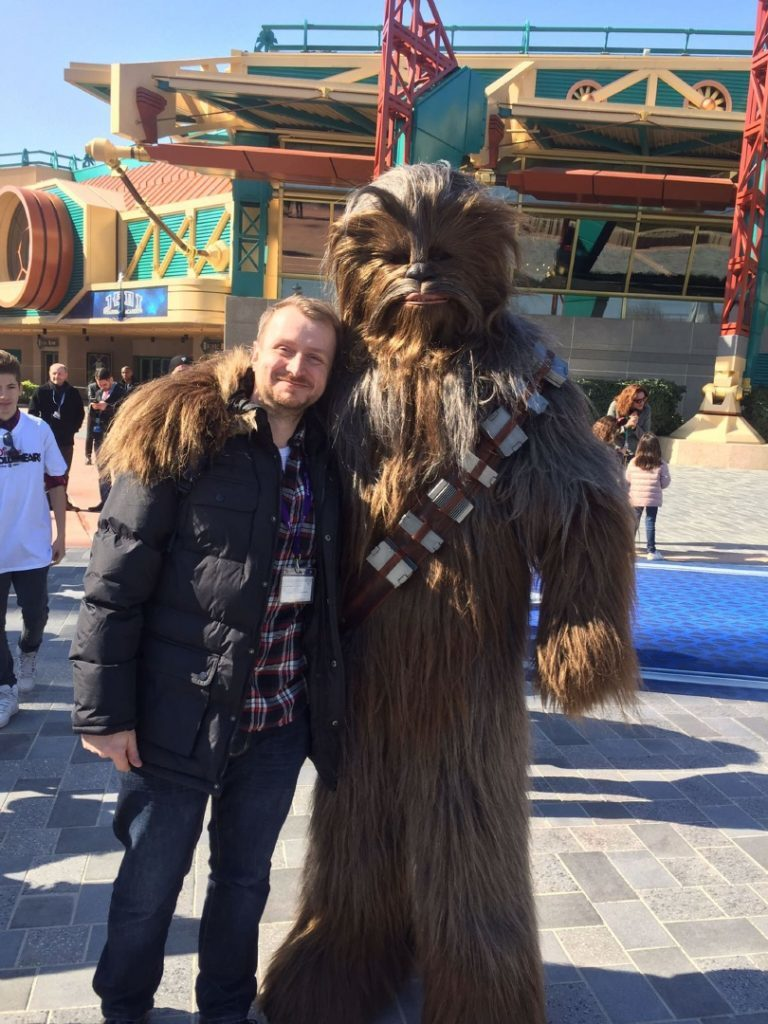 Photo of Damon Smith with Chewbacca.