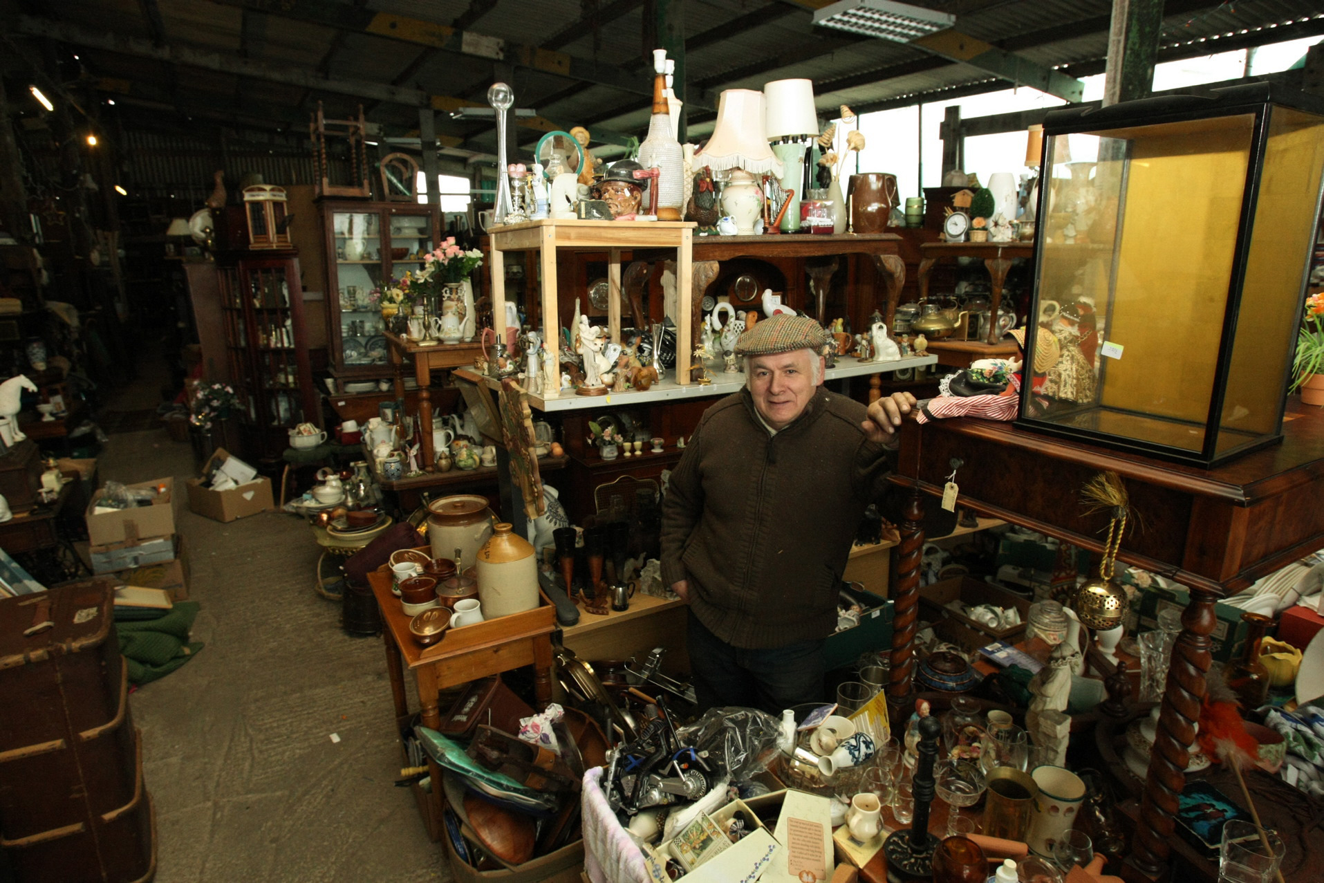 Peter Harrison beside a small part of his collection.