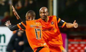 Wato Kuate celebrates his goal with William Edjenguele.