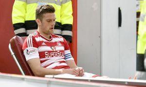 Michael Devlin is stretchered off on Saturday.