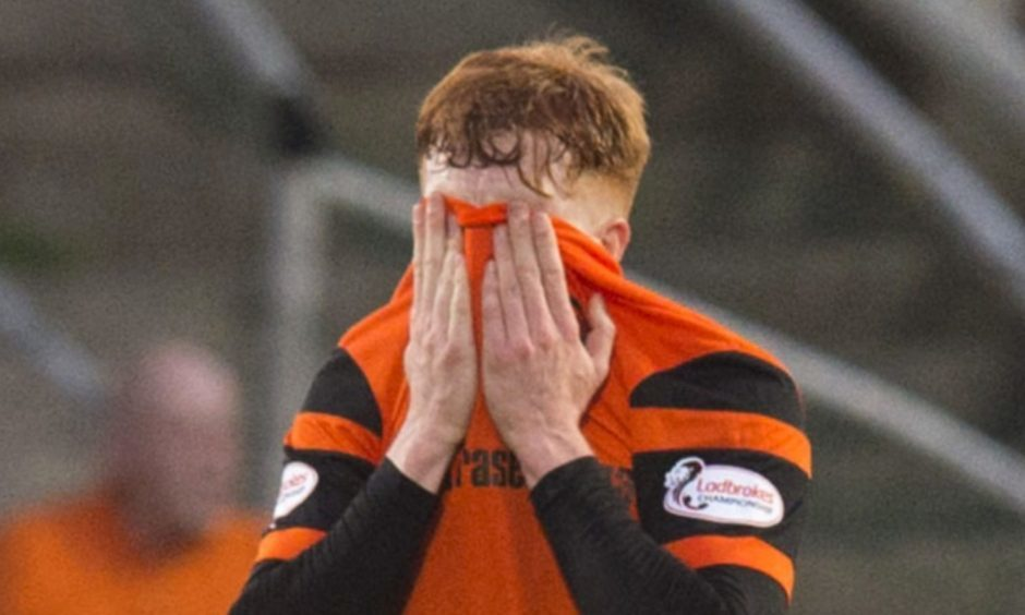 Simon Murray shows his red card frustration.