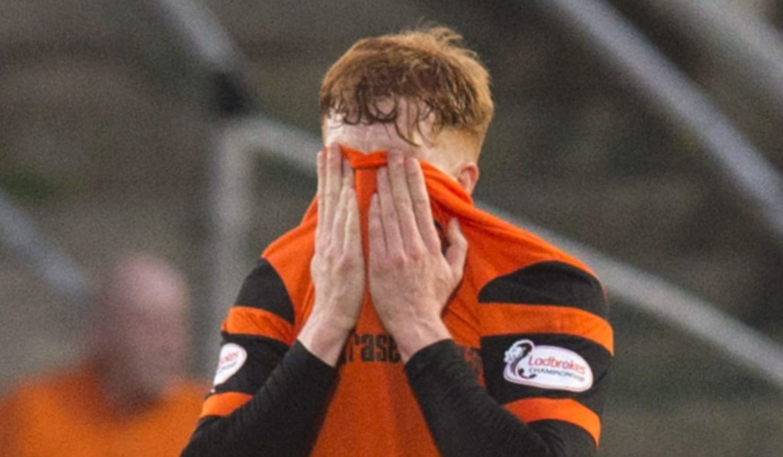 Simon Murray is distraught after red card.