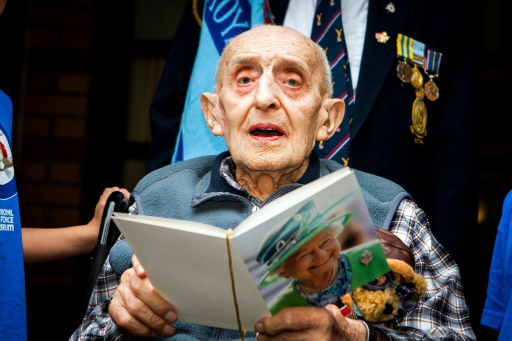 Gerald Lane OBE with his card from the Queen on his 100th birthday.