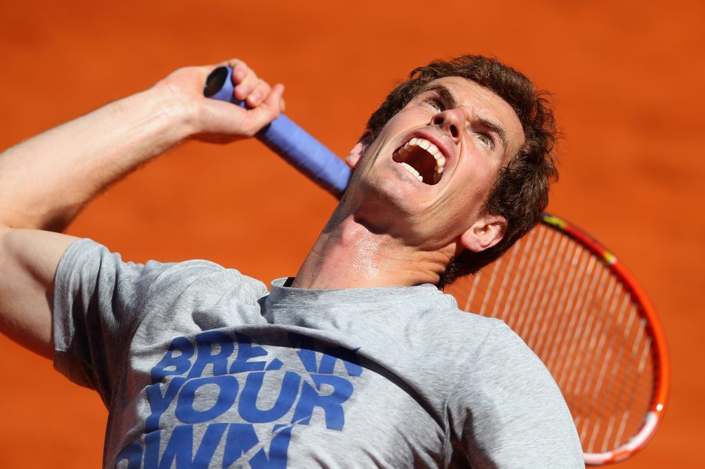 Andy Murray serves in a practice session during day one of the Mutua Madrid Open tennis tournament at the Caja Magica on May 3, 2014 in Madrid, Spain.
