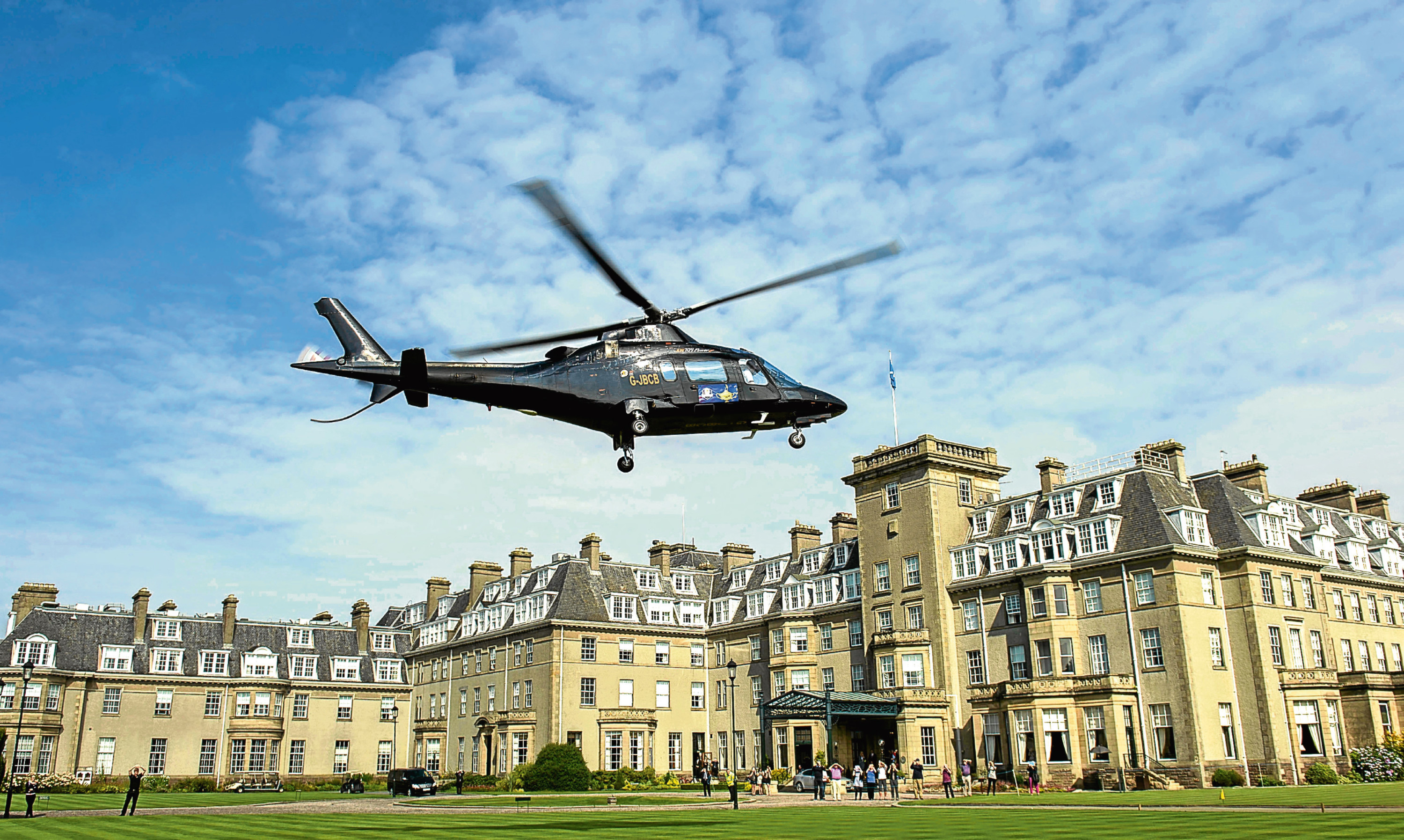 A helicopter lands at Gleneagles Hotel